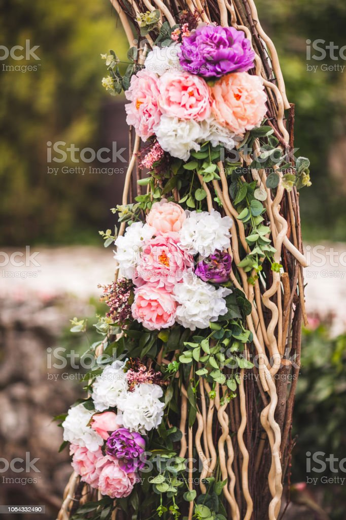 Wedding decorations with fresh pink and purple color flowers close...