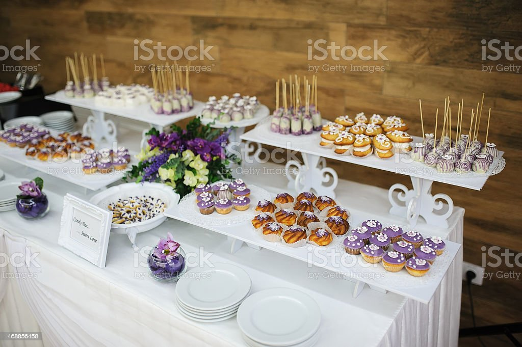 wedding dessert with delicious cakes and macaroons stock photo