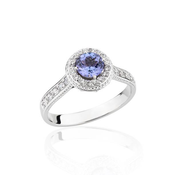 Wedding diamond ring with blue gemstone isolated on a white background stock photo