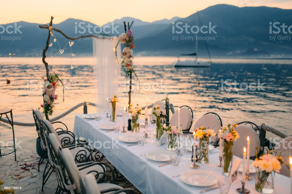 Wedding dinner by the sea. Wedding banquet at the sea. Donja Las stock photo