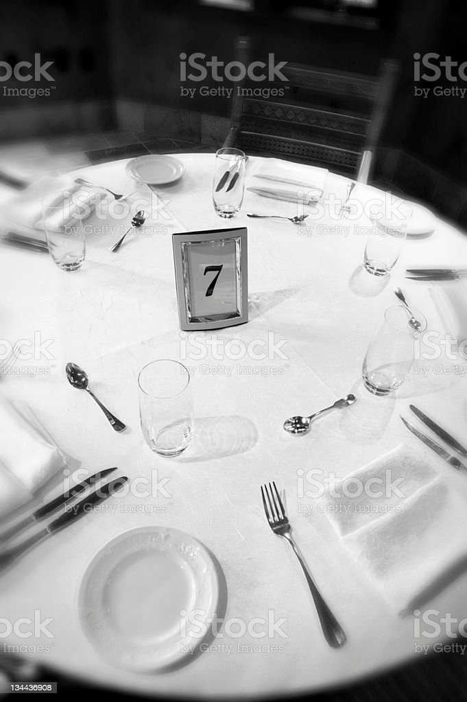 Wedding Dinner Table Setup of Dishes, Glasses and Silverware