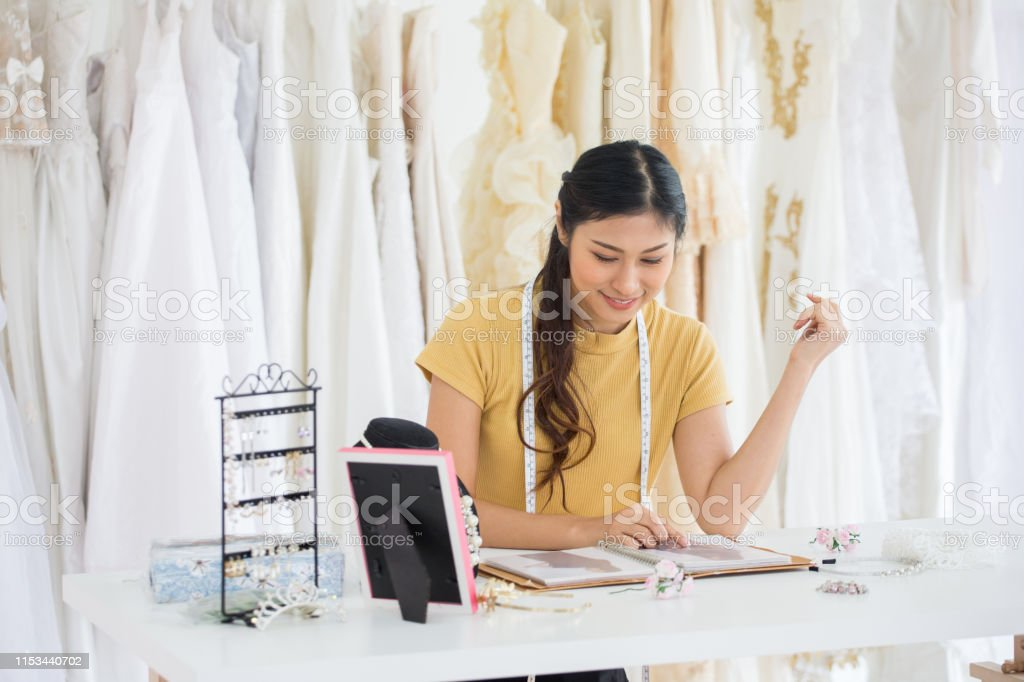 Wedding Dress Designer Working In Wedding Salon Of Fashion Store Stock Photo Download Image Now Istock