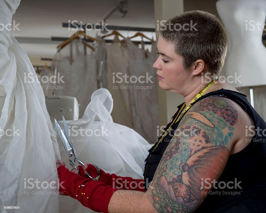 Wedding Dress Designer_Tattoos and Buzzed Hair stock photo