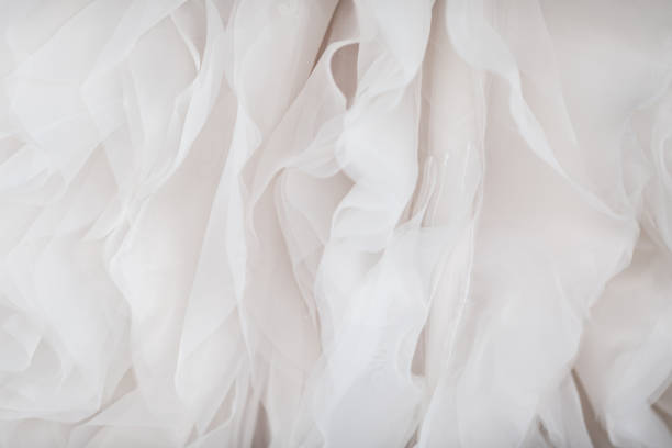 Wedding dress fabric close up Close up of white wedding dress lace and fabric lace textile stock pictures, royalty-free photos & images