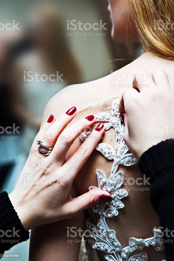 Wedding dress fitting in bridal boutiqe stock photo