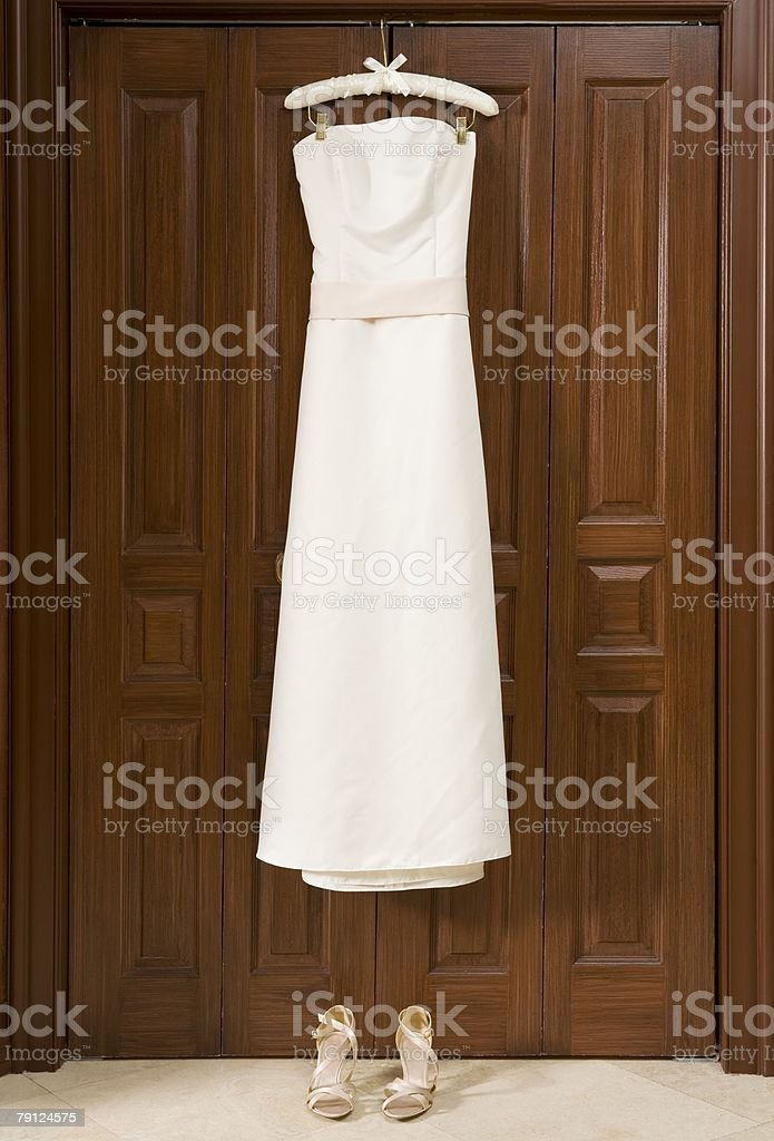 Wedding dress hanging on wardrobe 免版稅 stock photo