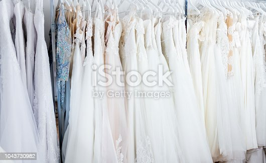 Wedding dresses hanging in boutique. New fashion collection from designer.