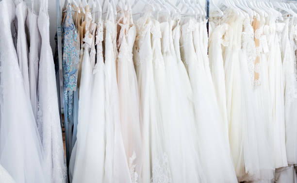 Wedding dresses hanging at boutique Wedding dresses hanging in boutique. New fashion collection from designer. wedding dress stock pictures, royalty-free photos & images