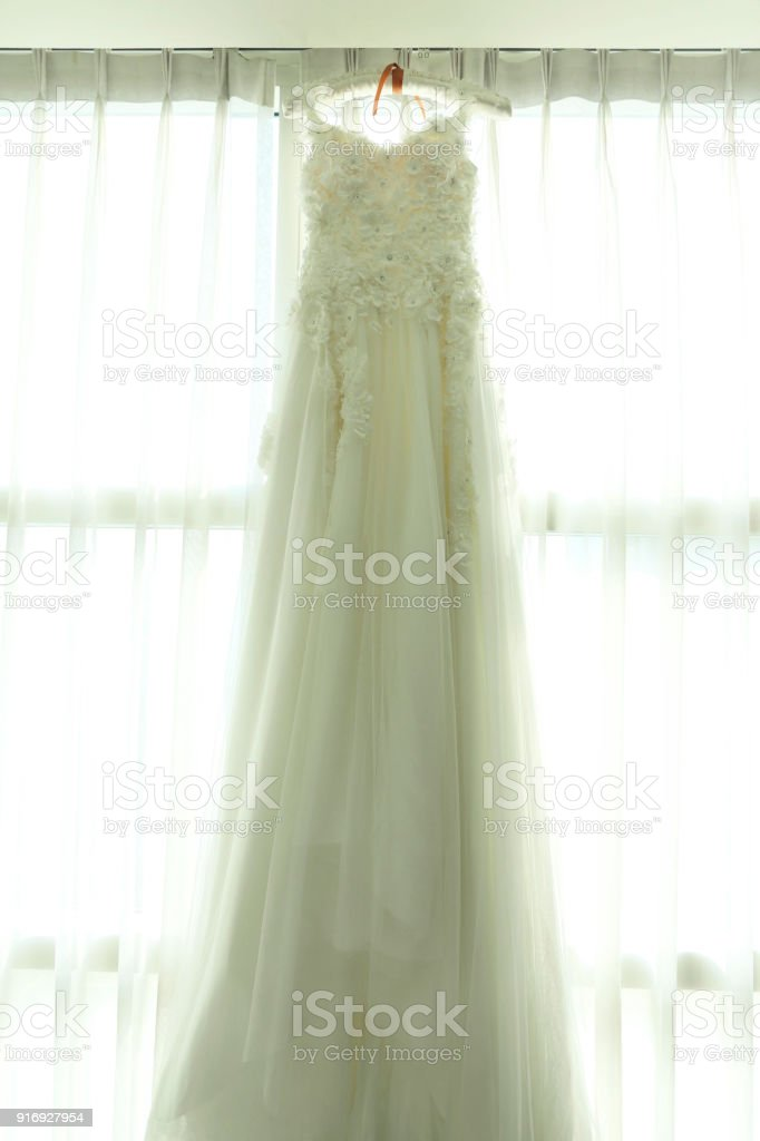 Wedding Dresses Hanging On A Curtain Fabrics Translucent Stock Photo ...