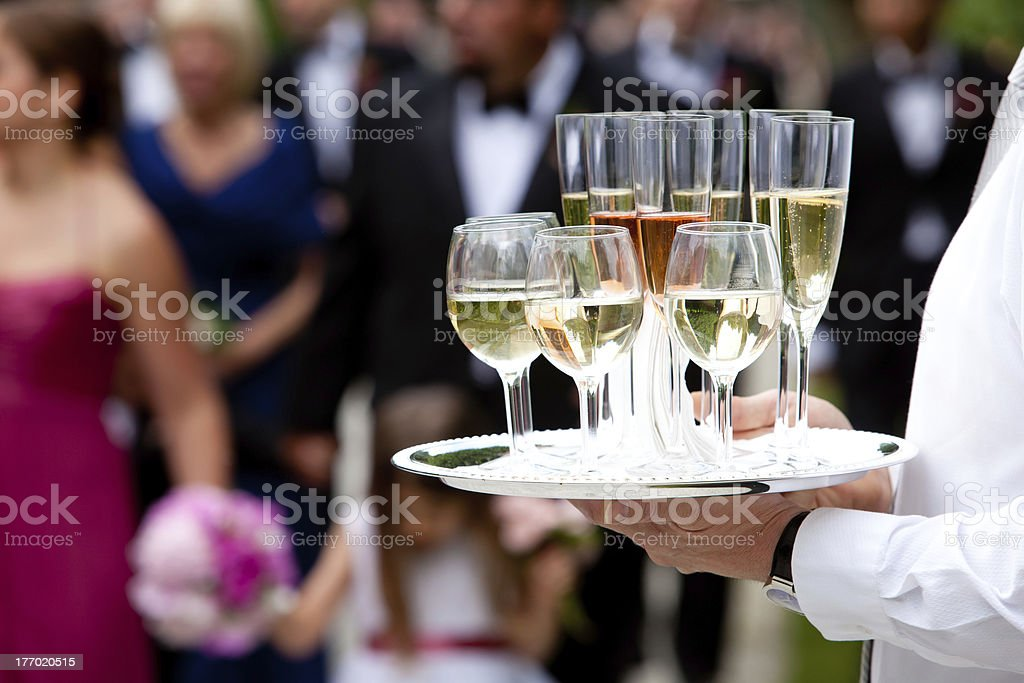 Wedding drinks served by a waiter stock photo