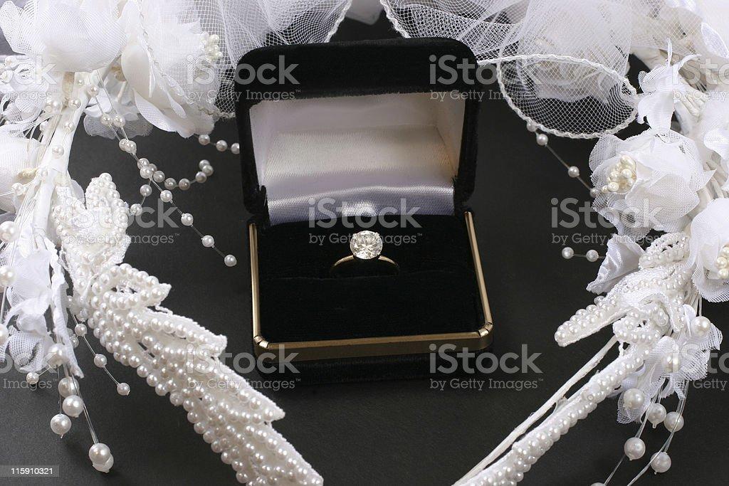 Wedding, engagement diamond ring and bridal veil. 2 carats. royalty-free stock photo