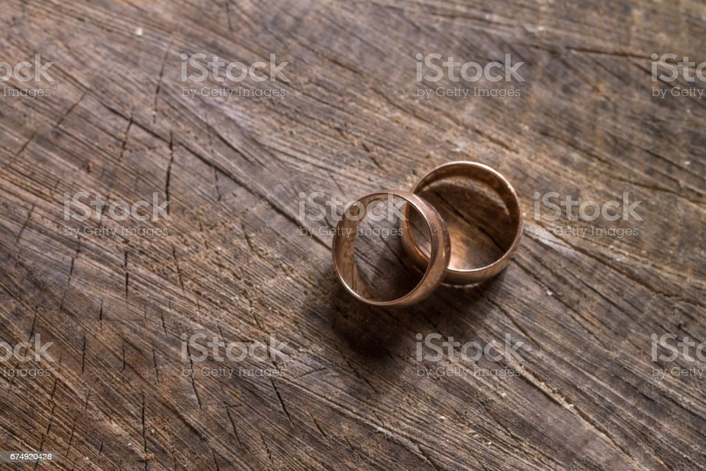 Wedding engagement rings on the old wooden stump royalty-free stock photo