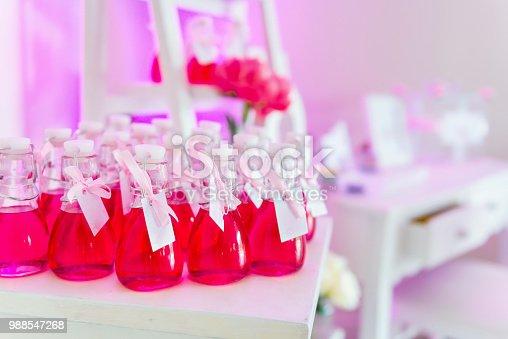 155315629istockphoto Wedding favor in jar 988547268