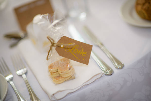 Wedding Favours Wedding Favours, Welsh cakes in heart shape with Love Tag welsh culture stock pictures, royalty-free photos & images