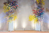 istock Wedding floral backdrops in marriage ceremony, Lover and Valentine, colorful flower mockup display on the stage 1203138467