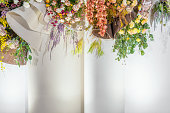 istock Wedding floral backdrops in marriage ceremony, Lover and Valentine, colorful flower mockup display on the stage 1205291022