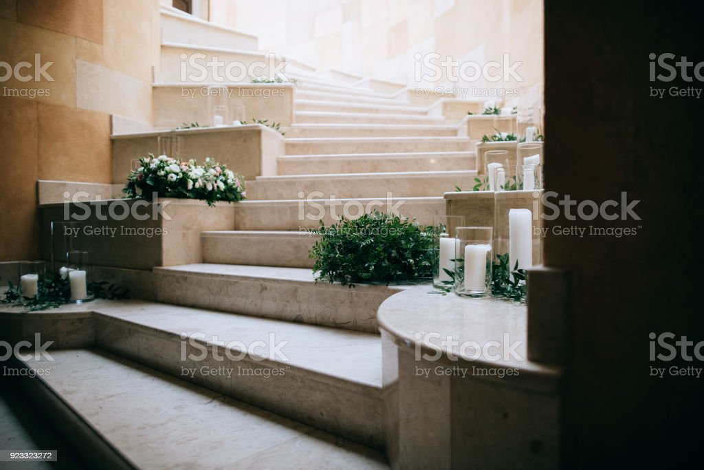 Wedding floral decoration on the stairs with white candles stock wedding floral decoration on the stairs with white candles royalty free stock photo junglespirit Image collections