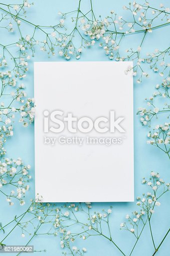 istock Wedding floral mockup with paper note, flowers gypsophila. Flat lay. 621980092