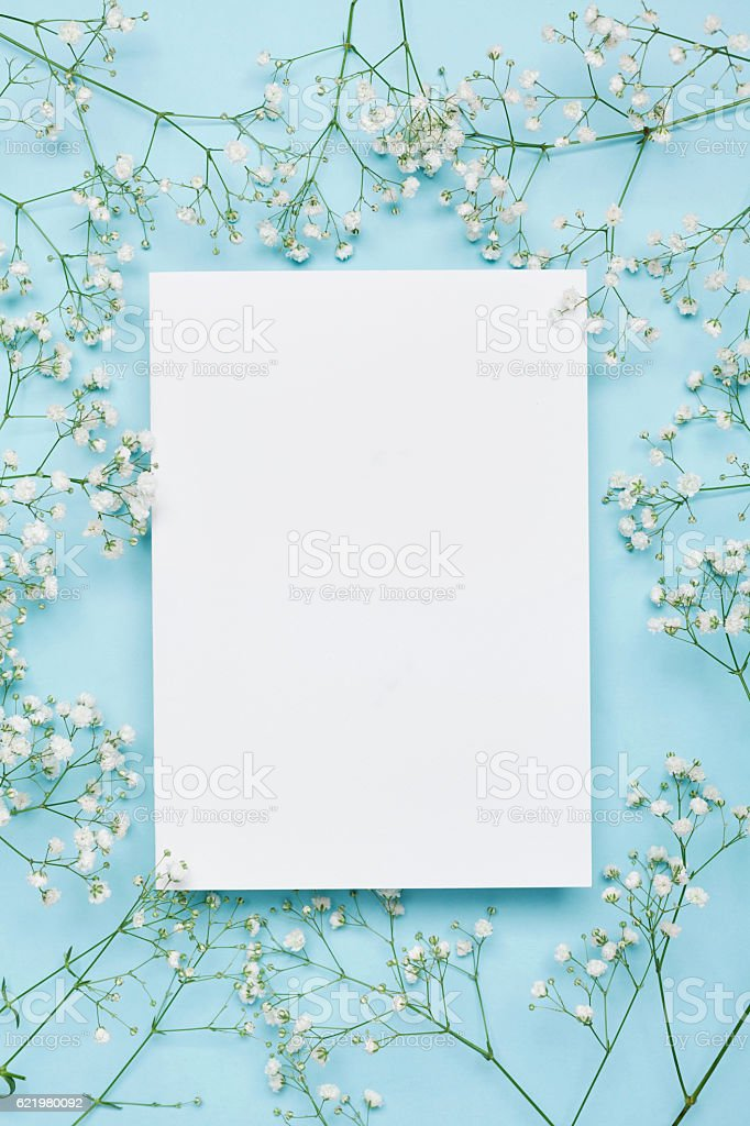Wedding floral mockup with paper note, flowers gypsophila. Flat lay. stock photo