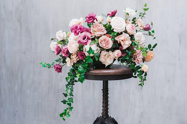 wedding flower arrangement isolated on grey textured background - brautstrauß aus holz stock-fotos und bilder