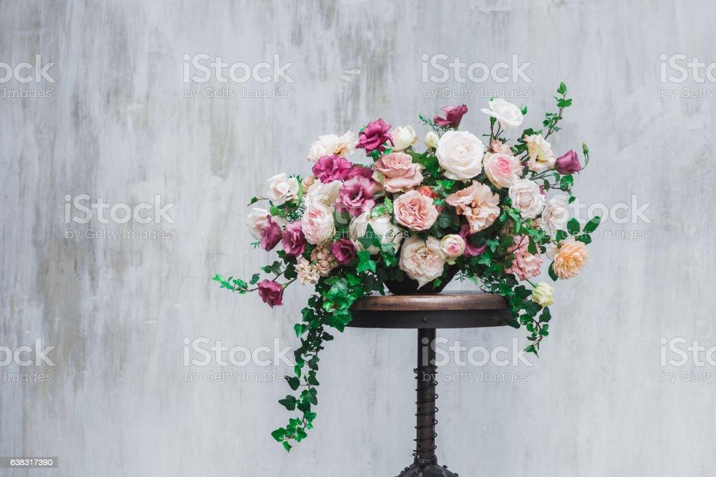 Wedding flower arrangement isolated on grey textured background stock photo