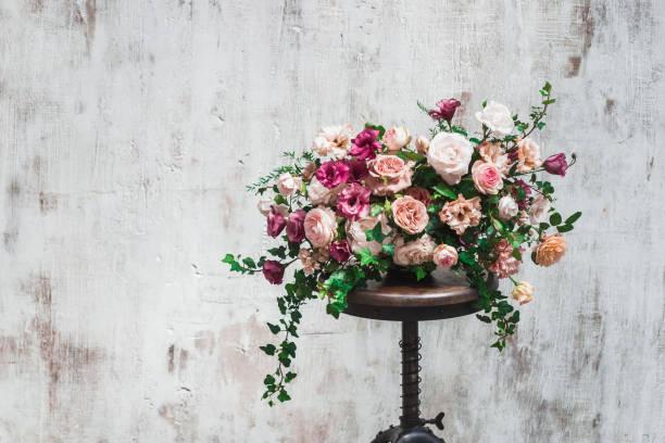 wedding flower arrangement isolated on white painted background - brautstrauß aus holz stock-fotos und bilder