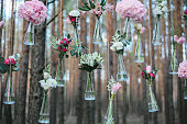 Wedding flowers decoration arch in the forest.
