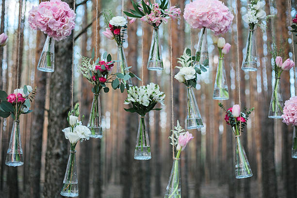 Wedding flowers decoration arch in the forest. – Foto