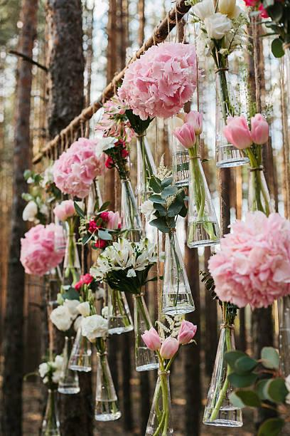 wedding flowers decoration arch in the forest. - grüne wald hochzeiten stock-fotos und bilder
