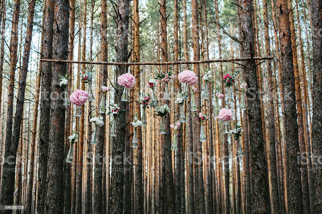 Wedding flowers decoration arch in the forest. - Photo