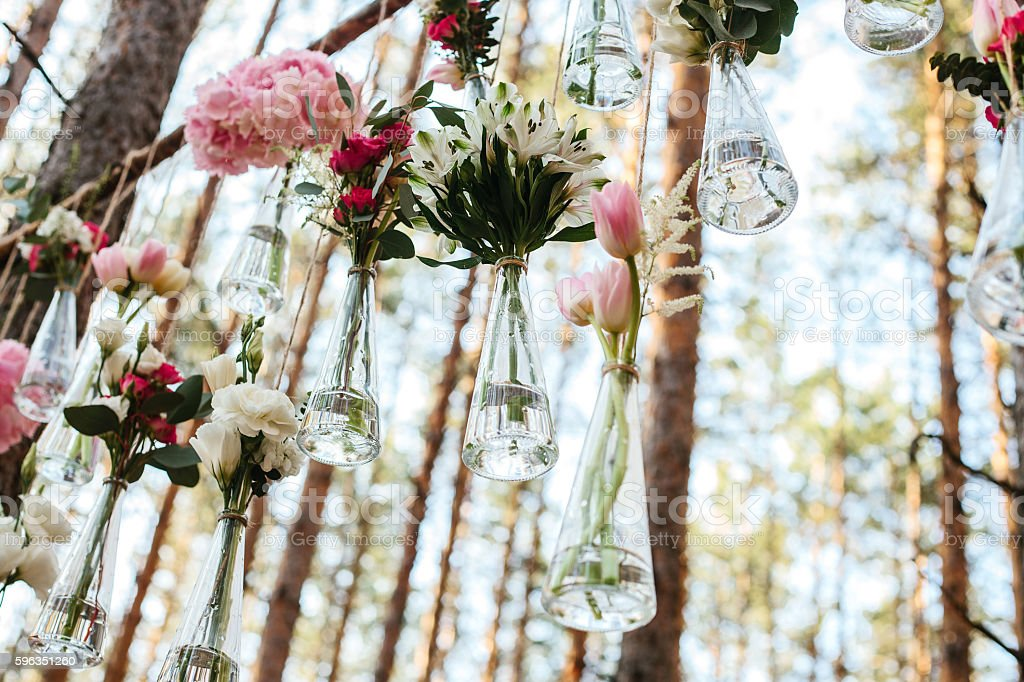 Wedding flowers decoration arch in the forest. royalty-free stock photo
