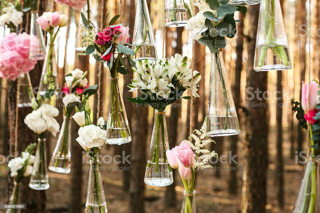 Wedding flowers decoration arch in the forest. stock photo