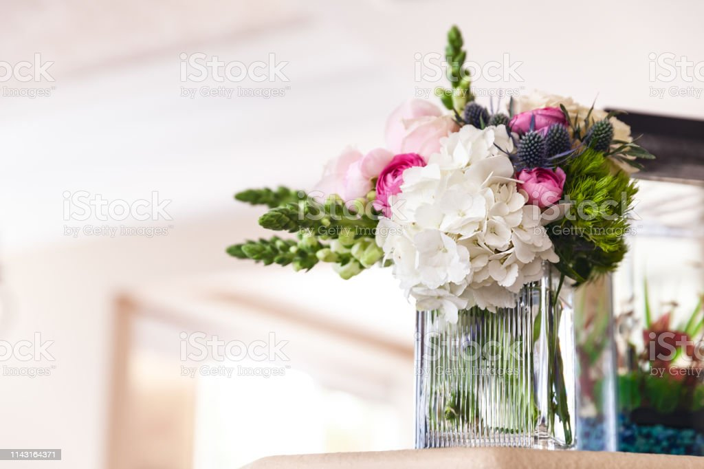 Wedding flowers in a vase in the morning before a ceremony stock photo