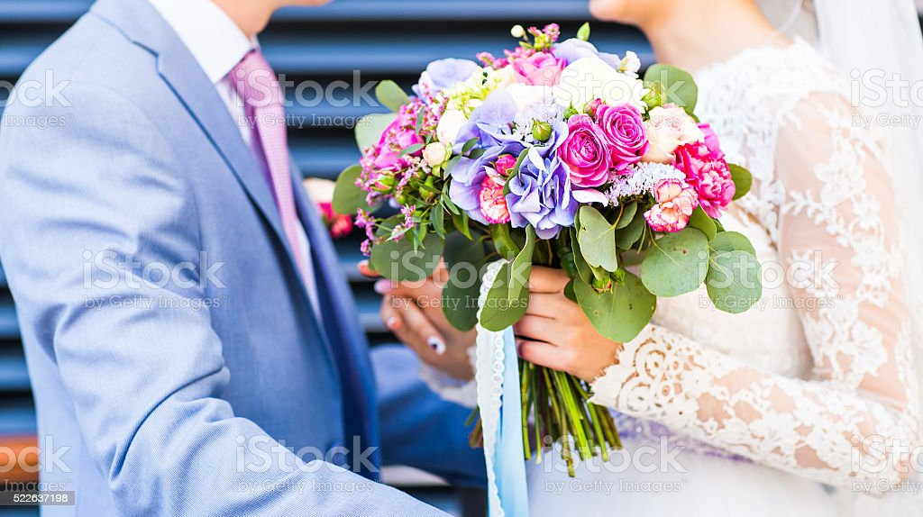 Wedding flowers ,Woman holding colorful bouquet with her hands on stock photo