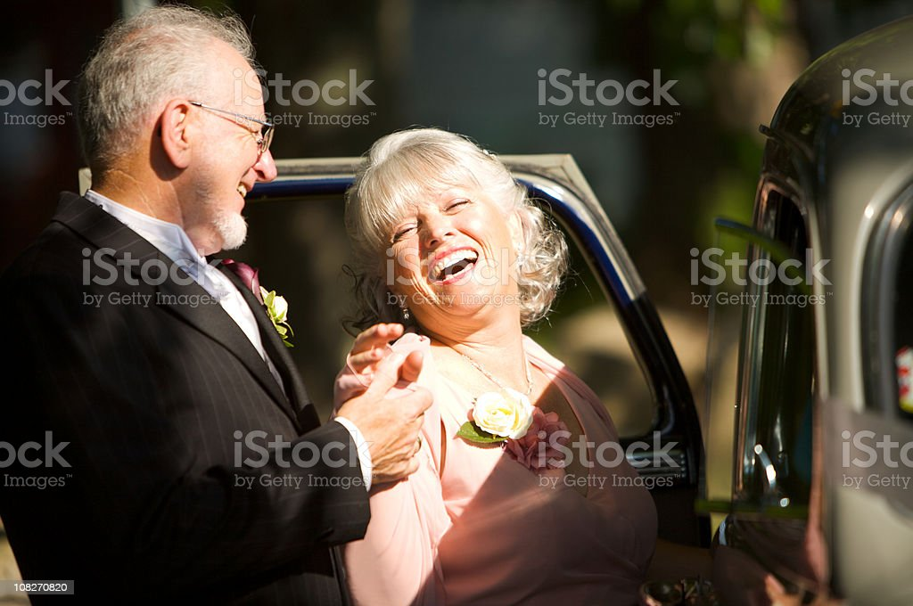 wedding geting into a car stock photo