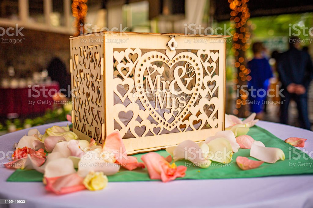 Wedding gift donation box on the table summer day