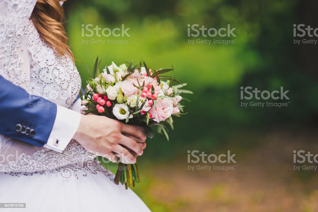 Wedding gift of the groom in the hands of bride stock photo