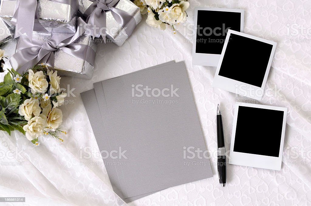 Wedding gifts with writing paper and photos royalty-free stock photo