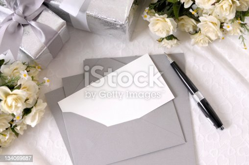 Writing paper or wedding invitation with envelope laid on bridal lace with several wedding gifts and white rose bouquets.  To see my complete collection of wedding backgrounds please CLICK HERE.   Alternative version of this file shown below: