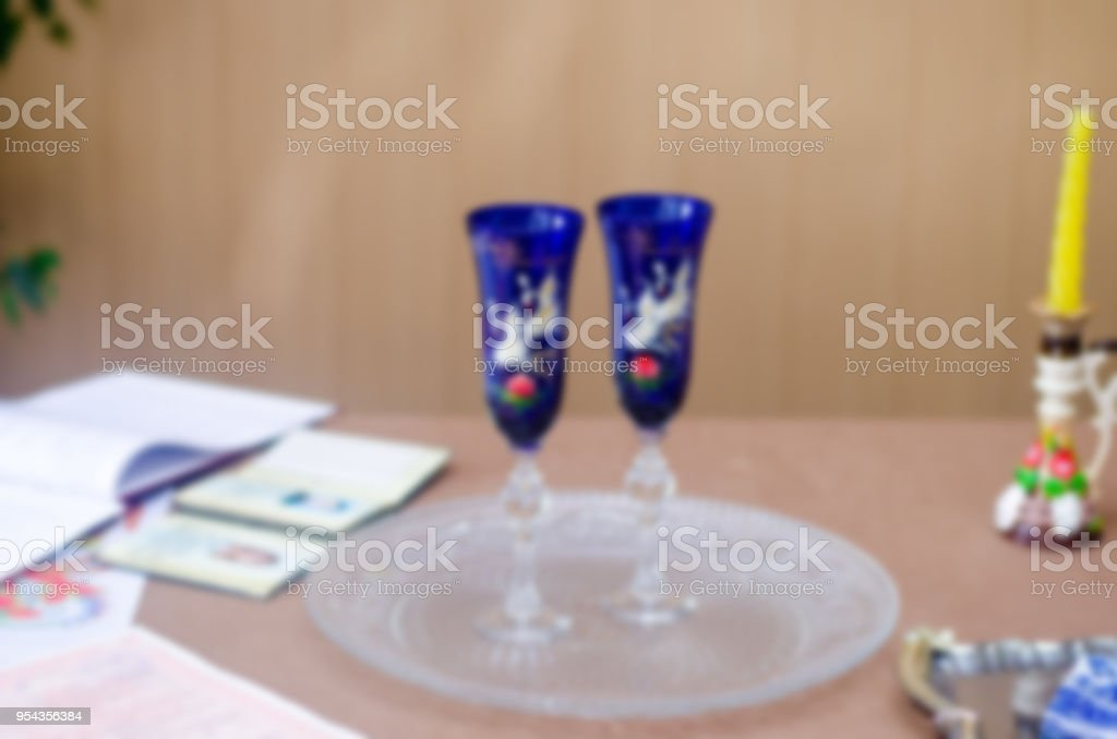 Wedding glass and passports on the table, blurred background, wedding concept stock photo