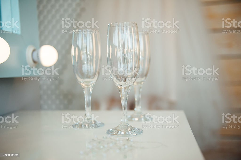 Wedding glasses filled with champagne at banquet royalty-free stock photo