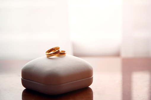 Wedding gold rings lie on a box