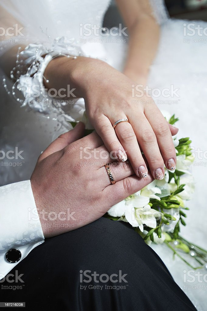 Wedding gold rings with diamonds on hands royalty-free stock photo