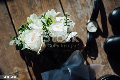 625840656 istock photo Wedding groom accessories. Shoes, bouquet, belt and socks in a top view. 1084872556