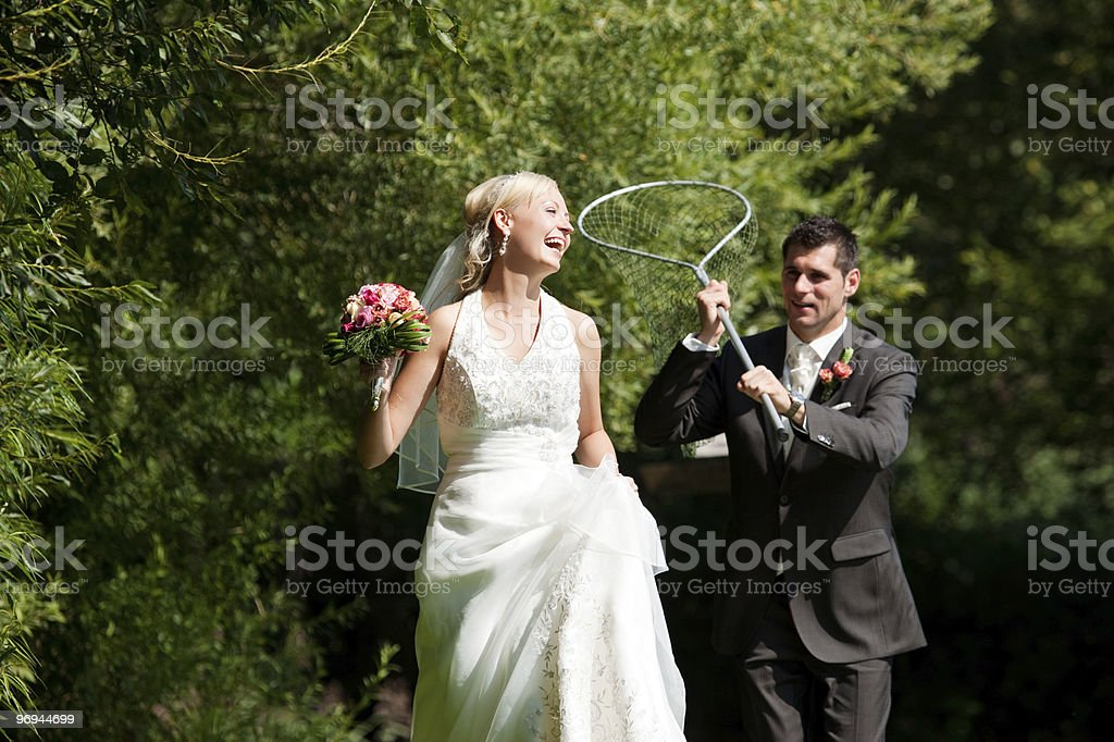 Wedding - Groom catching his bride with dip net royalty-free stock photo