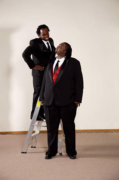 wedding groom groomsman portraits stock photo
