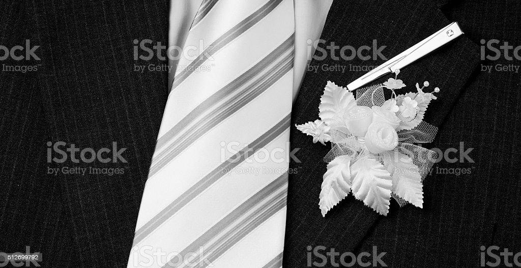 wedding groom suit ,tie and flower closeup stock photo