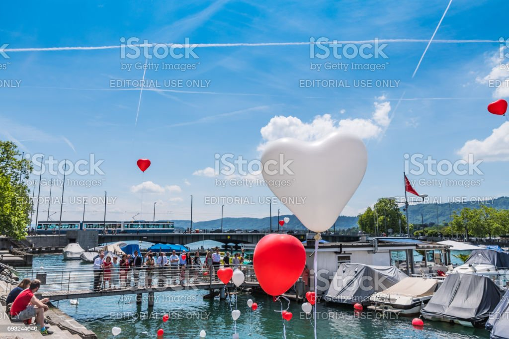 Wedding group release balloons in Zurich stock photo