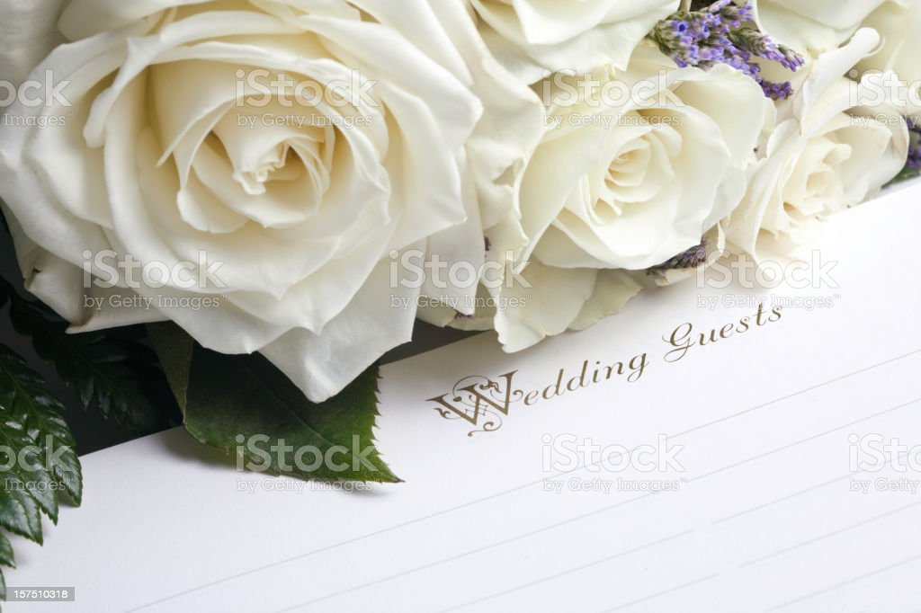 Wedding Guest Book and Bouquet stock photo