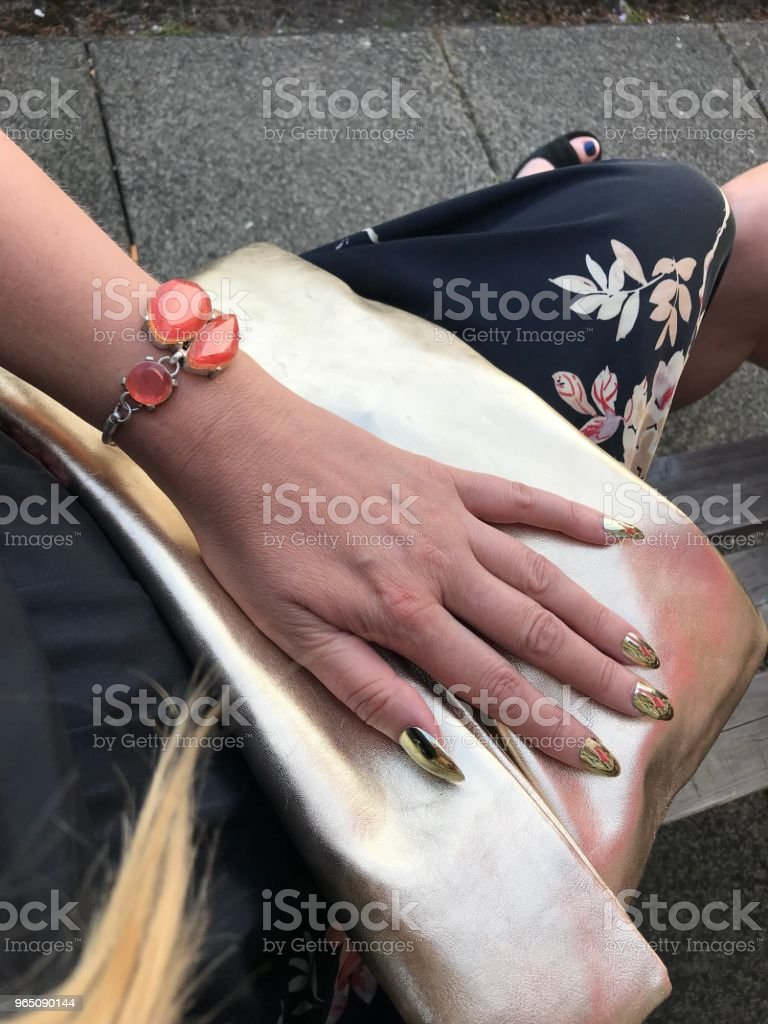 Wedding Guest Hand with Gold Fingernails royalty-free stock photo